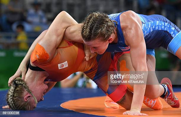 Netherland's Blaszka Jessica wrestles USA's Augello Haley Ruth in their women's 48kg qualification match on August 17 during the wrestling event of...