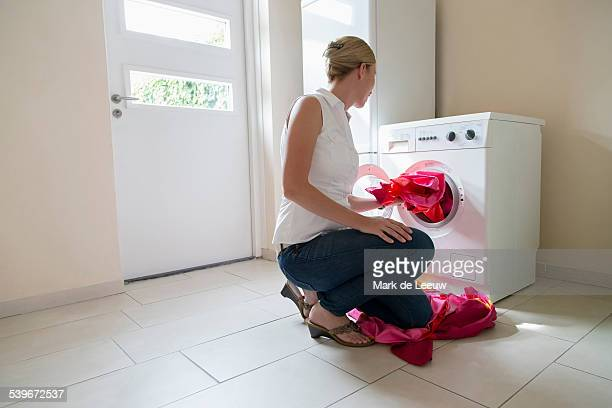 Netherlands, Brabant, Goirle, Woman taking laundry out of washing machine