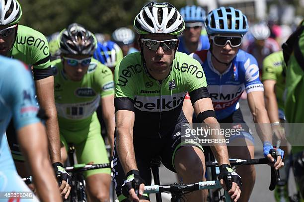 Netherland's Bram Tankink and others Dutch riders of the Netherlands' Belkin cycling team wear a black armband for the Malaysia Airlines plane crash...