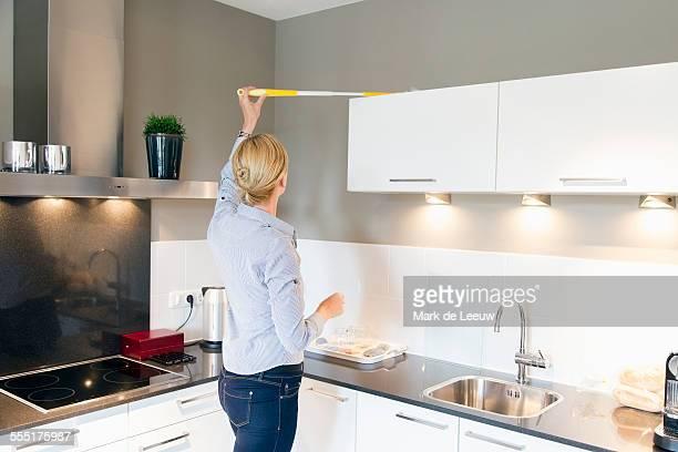 Netherlands, Breda, Woman cleaning kitchen
