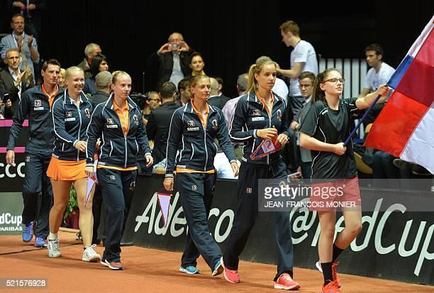 Netherland's captain Paul Haarhuis Kiki Bertens Richel Hogenkamp Cindy Burger Arantxa Rus arrive prior to the Fed Cup World Group second round semi...