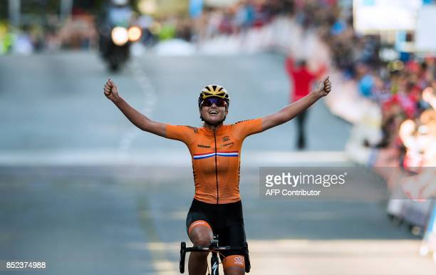 Netherlands' Chantal Blaak celebrates as she crosses the finish line to win the women elite road race of the UCI Cycling Road World Championships in...