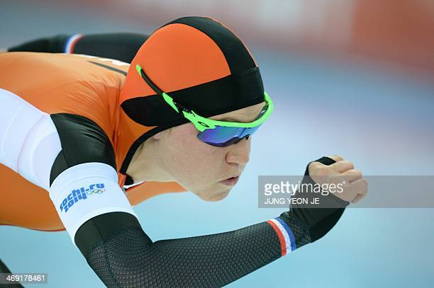 Netherlands' Charlotte van Beek competes during the Women's Speed Skating 1000 m at the Adler Arena during the Sochi Winter Olympics on February 13...