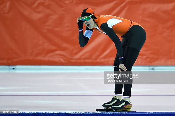 Netherlands' Charlotte van Beek reacts after the Women's Speed Skating 1000 m at the Adler Arena during the Sochi Winter Olympics on February 13 2014...