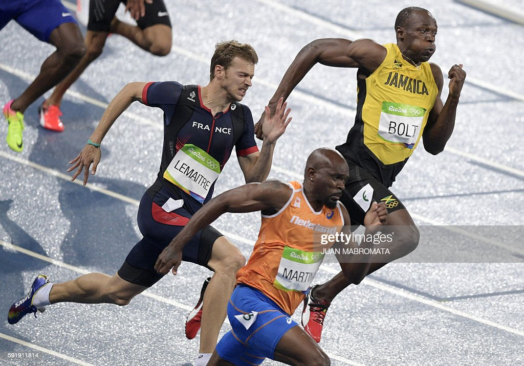 Netherlands Churandy Martina France's Christophe Lemaitre and Jamaica's Usain Bolt compete in the Men's 200m Final during the athletics event at the...