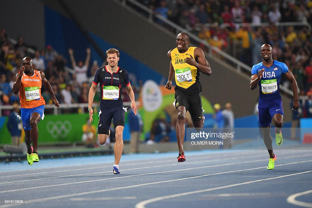 Netherlands Churandy Martina France's Christophe Lemaitre Jamaica's Usain Bolt and USA's Lashawn Merritt compete in the Men's 200m Final during the...