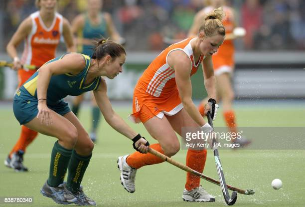 Netherland's Claire Verhage is challenged by Australia's Jayde Taylor during the Rabo FIH Women's Champions Trophy match at the Wagener Stadium...