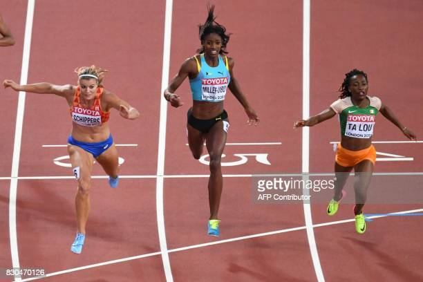 Netherlands' Dafne Schippers Bahamas's Shaunae MillerUibo Ivory Coast's MarieJosée Ta Lou cross the finish line of the final of the women's 200m...