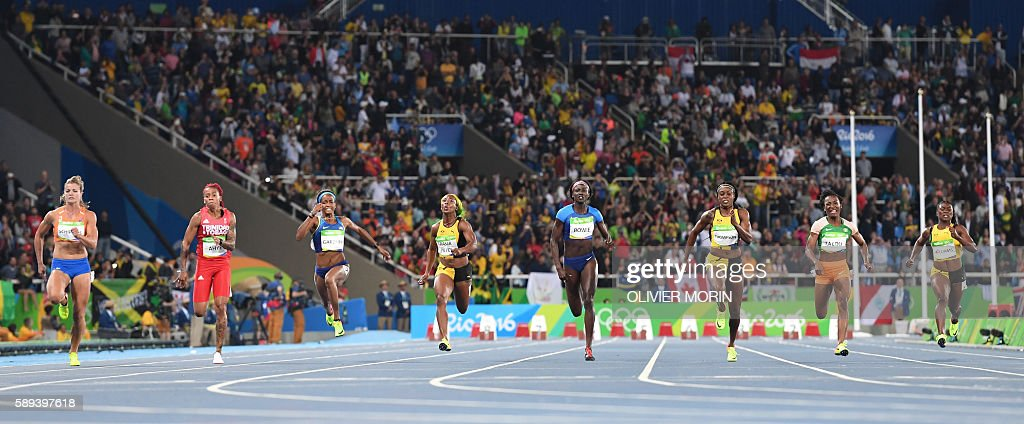 TOPSHOT - (FromL) Netherland's Dafne Schippers, Trinidad and Tobago's Michelle-Lee Ahye, USA's English Gardner, Jamaica's Shelly-Ann Fraser-Pryce, USA's Tori Bowie, Jamaica's Elaine Thompson, Ivory Coast's Marie-Josee Ta Lou and Jamaica's Christania Williams compete in the Women's 100m Final during the athletics event at the Rio 2016 Olympic Games at the Olympic Stadium in Rio de Janeiro on August 13, 2016. / AFP / OLIVIER