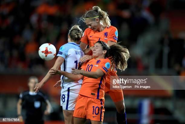 Netherlands' Danielle van de Donk and Anouk Dekker battle with England's Ellen White
