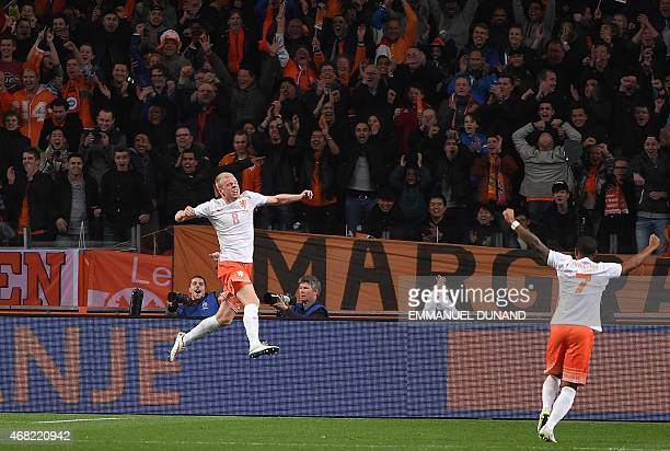 Netherland's Davy Klaassen celebrates after scoring a goal during the friendly football match Netherlands vs Spain in Amsterdam on March 31 2015 AFP...