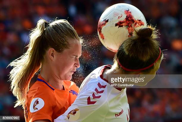 Netherlands' defender Desiree van Lunteren heads the ball as she vies for it with Denmark's midfielder Katrine Veje during the UEFA Womens Euro 2017...