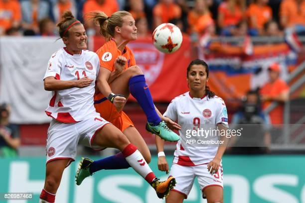 Netherlands' defender Desiree van Lunteren vies for the ball with Denmark's midfielder Katrine Veje and Denmark's forward Nadia Nadim during the UEFA...