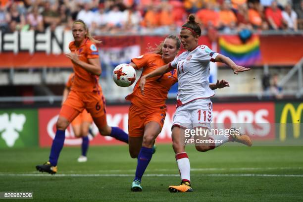 Netherlands' defender Desiree van Lunteren vies for the ball with Denmark's midfielder Katrine Veje during the UEFA Womens Euro 2017 football...
