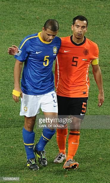 Netherlands' defender Giovanni van Bronckhorst embraces Brazil's midfielder Felipe Melo after he committed a foul on Netherlands' striker Arjen...
