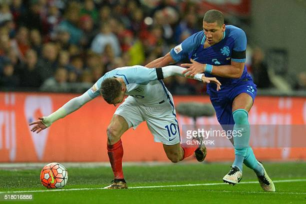 Netherlands' defender Jeffrey Bruma challenges England's striker Jamie Vardy during the international friendly football match between England and...