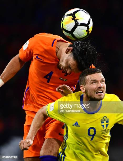 Netherlands' defender Karim Rekik and Sweden's forward Marcus Berg vie for the ball during their FIFA World Cup 2018 football Group A qualification...