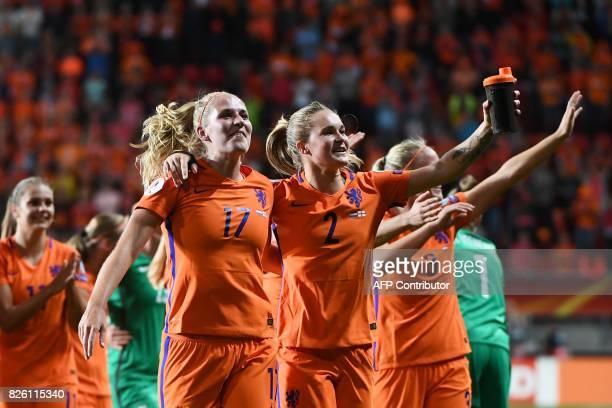 Netherlands' defender Kelly Zeeman and Netherlands' defender Desiree van Lunteren celebrate after winning the UEFA Womens Euro 2017 football...