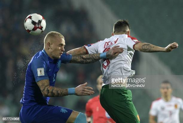 Netherland's defender Rick Karsdorp vies with Bulgaria's Forward Spas Delev during the FIFA World Cup 2018 qualification football match between...