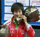 ROTTERDAM Netherlands Ding Ning of China shows off her gold medal after winning the women's singles competition at the world table tennis...