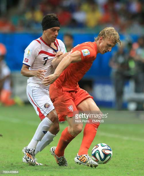 Netherland's Dirk Kuyt and Costa Rica's Christian Bolanos battle for the ball