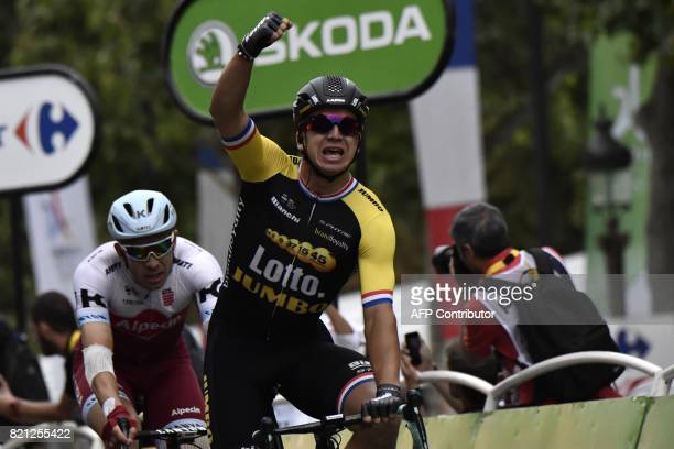 Netherlands' Dylan Groenewegen celebrates as he crosses the finish line to win ahead of Norway's Alexander Kristoff during the 103 km twentyfirst and...