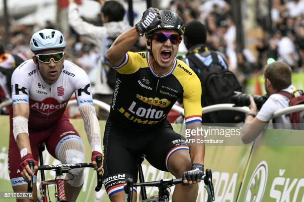 Netherlands' Dylan Groenewegen celebrates as he crosses the finish line to win ahead of Norway's Alexander Kristoff at the end of the 103 km...