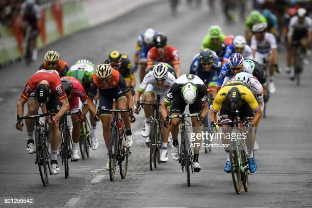 Netherlands' Dylan Groenewegen Germany's Andre Greipel and Norway's Edvald Boasson Hagen sprint towards the finish line at the end of the 103 km...