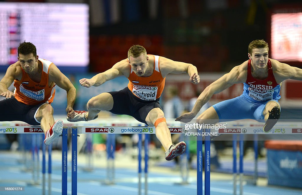 Netherlands' Eelco Sintnicolaas, Netherlands' Pelle Rietveld and Russia's Artem Lukyanenko compete in 60m Hurdles combined 1st heat of the Heptathlon event at the European Indoor Athletics Championships in Gothenburg, Sweden, on March 3, 2013.