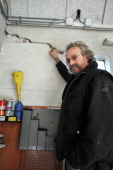 Netherland's Elze Schollema shows a crack in his garage wall on March 12 2013 in Usquert some 25km from Groningen caused by an earthquake in February...