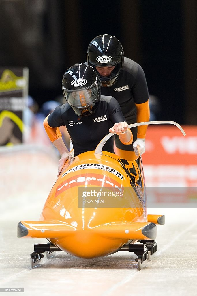Netherland's Emse Kamphuis (L) and Willy Kanis take part in the first run during the Women's Bobsleigh competition at the Sanki Sliding Centre, some 50 km from Russia's Black Sea resort of Sochi, on February 15, 2013. With a year to go until the Sochi 2014 Winter Games, construction work continues as tests events and World Championship competitions are underway. AFP PHOTO / LEON NEAL