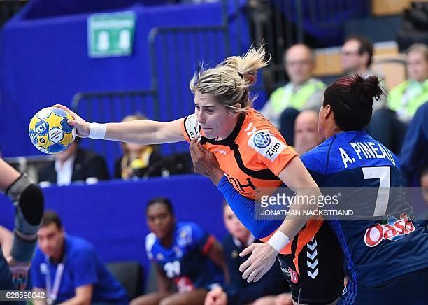 Netherlands' Estavana Polman and France's Allison Pineau vie for the ball during the Women's European Handball Championship Group B match between...