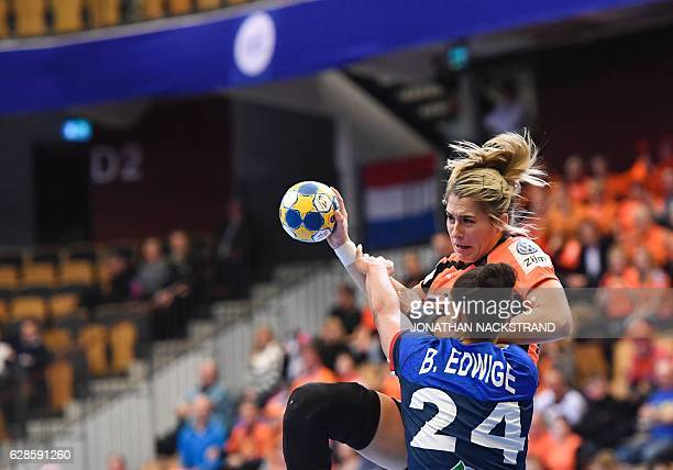 Netherlands' Estavana Polman and France's Beatrice Edwige vie for the ball during the Women's European Handball Championship Group B match between...