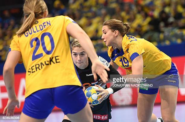 Netherlands' Estavana Polman and Sweden's Anna Lagerquist vie for the ball during the Women's European Handball Championship Group I match between...