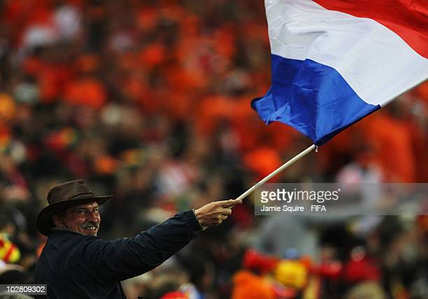 Netherlands fan enjoys the atmosphere before the 2010 FIFA World Cup South Africa Final match between Netherlands and Spain at Soccer City Stadium on...