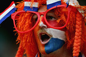 Netherlands fan shows his colours during the UEFA U21 Championship group A match between Netherlands U21 and Portugal U21 at the Euroborg Stadium on...