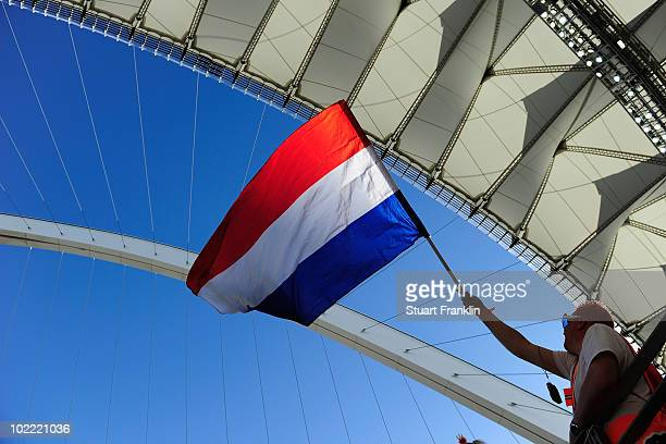Netherlands fan waves a flag as he enjoys the atmosphere prior to the 2010 FIFA World Cup South Africa Group E match between Netherlands and Japan at...