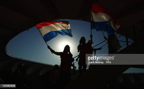 Netherlands fans wave their flags during the 2010 FIFA World Cup South Africa Quarter Final match between Netherlands and Brazil at Nelson Mandela...