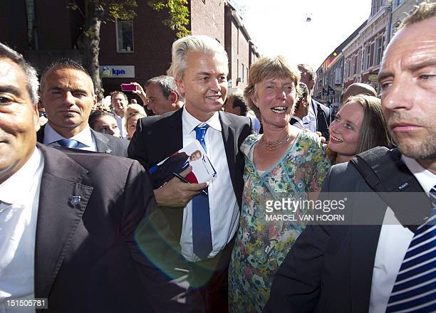 Netherlands' far rightwing Party for Freedom leader Geert Wilders and PVV parlementarian Fleur Agema walk in the streets of Roermond on September 8...