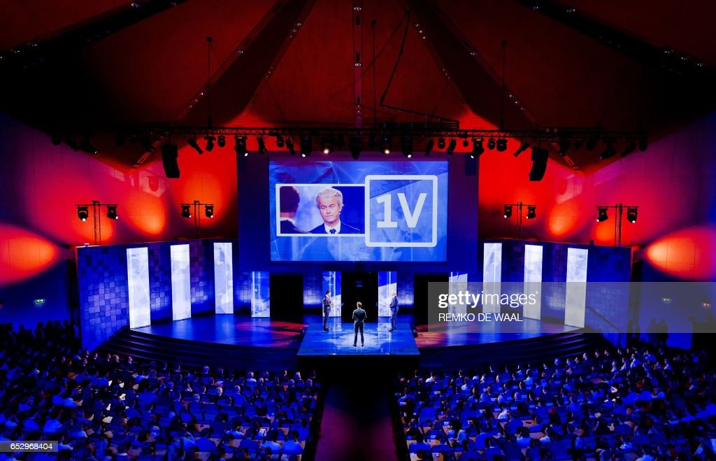 Netherlands' far-right politician Geert Wilders of the PVV party (R) and Netherlands' prime minister Mark Rutte of the VVD Liberal party (L) debate onstage on March 13, 2017 in Rotterdam, prior to March 15 Dutch national elections. / AFP PHOTO / ANP / Remko de Waal / Netherlands OUT