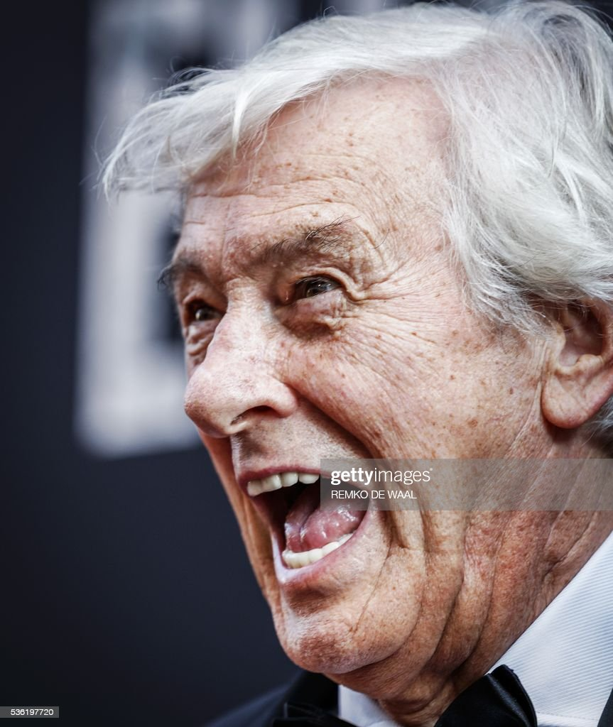 Netherlands' film director Paul Verhoeven reacts on the red carpet during the Netherlands' premiere of his latest movie Elle in Amsterdam on May 31, 2016. / AFP / ANP / Remko de Waal / Netherlands OUT