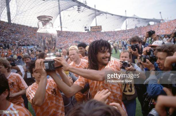 Netherlands football team captain Ruud Gullit raises the UEFA European Championship trophy in the air after Netherlands beat the Soviet Union 20 to...