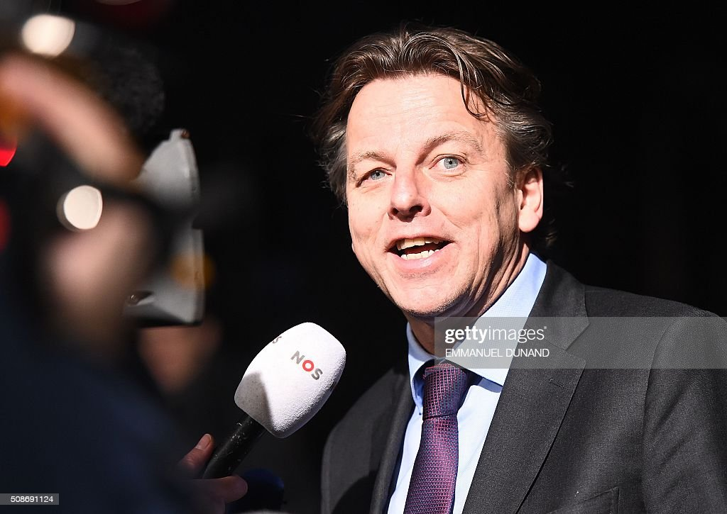Netherlands' Foreign Minister Bert Koenders answers journalists' questions as he arrives to take part in a EU foreign ministers meeting in Amsterdam, on February 6, 2016. The European Union on Wednesday finally reached agreement on how to finance a three-billion-euro ($3.3-billion) deal to aid Syrian refugees in Turkey, in exchange for Ankara's help in stemming the flow of migrants. / AFP / EMMANUEL DUNAND