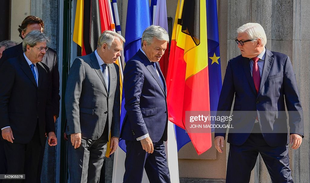 Netherlands' Foreign minister Bert Koenders, Italy's Foreign minister Paolo Gentiloni, France's Foreign minister Jean-Marc Ayrault, Belgium's Foreign minister Didier Reynders and Germany's Foreign minister Frank-Walter Steinmeier arrive for a group photo at the villa Borsig prior to post-Brexit talks in Berlin on June 25, 2016. Foreign ministers of the six founding members of the European project meet to discuss the bloc's future in the wake of Britain's decision to leave. / AFP / John MACDOUGALL