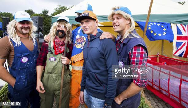 Netherlands Formula One driver Max Verstappen of Red Bull Racing poses with fans during the Red Bull Soapbox Race in Valkenburg on August 19 2017 /...
