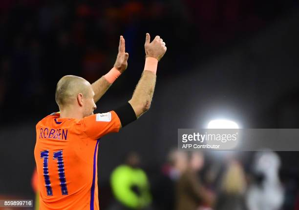 Netherlands' forward Arjen Robben acknowledged the fans following their FIFA World Cup 2018 football Group A qualification match between the...