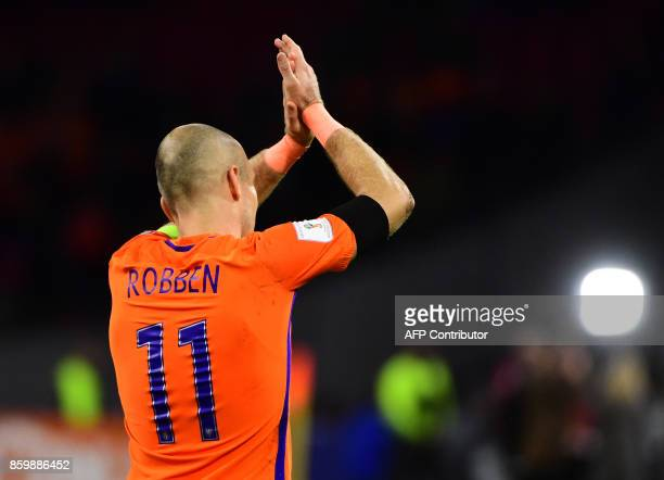 Netherlands' forward Arjen Robben acknowledges the fans following their FIFA World Cup 2018 football Group A qualification match between the...