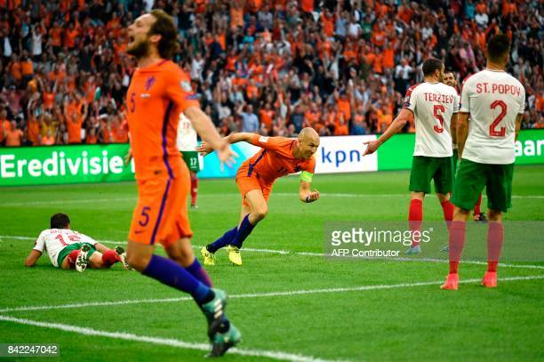 Netherlands forward Arjen Robben celebrates after scoring during the FIFA World Cup 2018 qualification football match between Netherlands and...