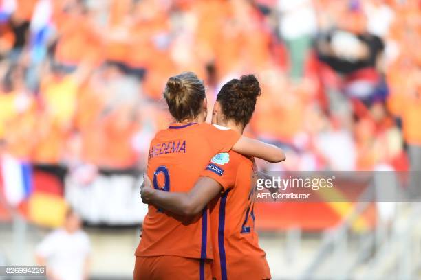 Netherlands' forward Vivianne Miedema celebrates with Netherlands' defender Dominique Janssen after scoring a goal during the UEFA Womens Euro 2017...