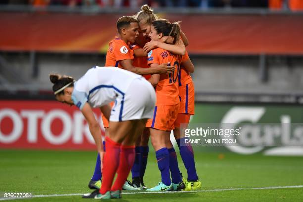 Netherlands' forward Vivianne Miedema celebrates with teammates after scoring a goal during the UEFA Womens Euro 2017 football tournament semifinal...